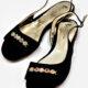 Schwarze Sandalen mit Strasssteinen